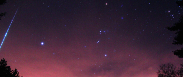 A croped close up of the Geminid fireball lining up with the winter stars.