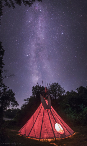 A fire ceremony inside the Tipi at Spirit Horse Farm, the Milky Way and summer triangle shine overhead.